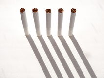 Cigarettes and tobacco products. Cigarettes and tobacco products paper nicotine filter habit Royalty Free Stock Photos