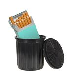 Cigarettes Trashed. Pack of cigarettes thrown away in a garbage can isolated on white Stock Photo