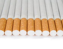Cigarettes on a white background Royalty Free Stock Images