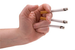 Cigarettes in a womans hand Royalty Free Stock Images