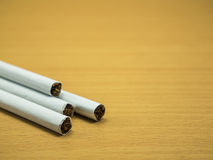Cigarettes on wooden background. And copy space Royalty Free Stock Photo