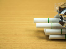 Cigarettes on wooden and copy space. Cigarettes on wooden background and copy space Royalty Free Stock Photography