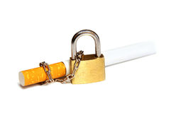 Cigarettes, wrapped a chain with a lock. Stock Image