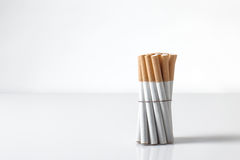 Cigarettes wrapped up on white Royalty Free Stock Photo