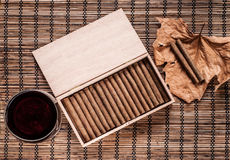 Cigarillos and wine Stock Photo
