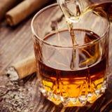 Cigarr och Cognac Fotografering för Bildbyråer