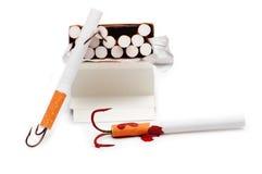 Cigarrillo con un gancho de pesca Fotos de archivo