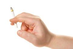 Cigarrillo humano de la explotación agrícola de la mano Fotografía de archivo libre de regalías