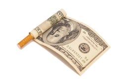 Cigarrillo y cientos billetes de dólar Foto de archivo