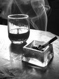 Cigarrillo y vino Imagen de archivo libre de regalías