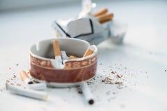 Cigarrillos en el cenicero Fotografía de archivo