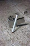 Cigarro com isqueiro Foto de Stock Royalty Free