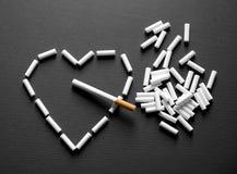 Cigarro no coração Imagens de Stock Royalty Free