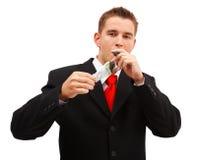 Cigarro rico de la iluminación del hombre de negocios Foto de archivo libre de regalías