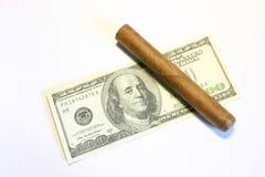 Cigarro y dólares Foto de archivo libre de regalías