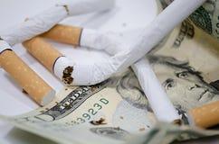 Cigarros com dólar Imagens de Stock Royalty Free