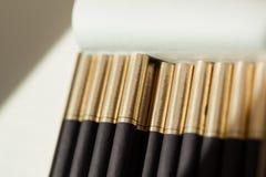 Cigarros no bloco Fotografia de Stock