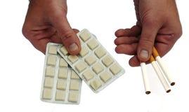 Cigarros ou goma? Imagem de Stock