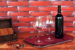 Cigarros y vino Foto de archivo libre de regalías