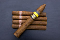 Cigars. Top view of five cubans cigars Royalty Free Stock Images
