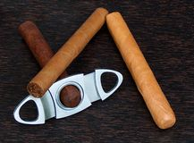 Cigars. With cigar cutter stock image