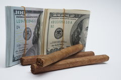 Cigars and cash Royalty Free Stock Photography