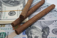 Cigars and cash Royalty Free Stock Image
