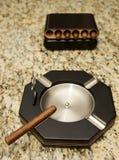 Cigars and cigar ashtray. Cigar ashtray with one cigar ready to smoke Stock Image