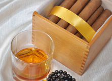 Cigars, cognac and pearls Stock Photos