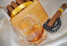 Cigars, cognac and pearls Stock Photography
