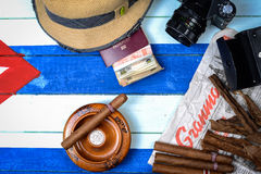 Cigars and communism newspaper with retro camera Stock Photo