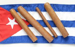 Cigars and Cuban flag. Cigars on the Cuban flag stock images