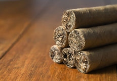 Cigars habanos huddled on wood background Stock Image