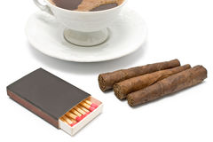 Cigars with matches and cup of coffee Royalty Free Stock Photos