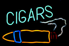 Cigars Neon Sign. Against Black Background Stock Image