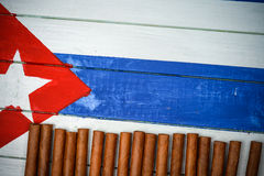 Cigars on painted Cuban national flag Stock Images