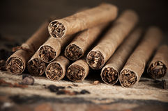 Cigars pile on wood Royalty Free Stock Photo