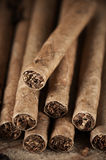 Cigars pile on wood Royalty Free Stock Photos