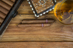Cigars and Rum or alcohol on table Royalty Free Stock Photography