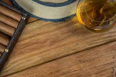 Cigars and Rum or alcohol on table Stock Images