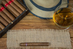Cigars and Rum or alcohol on table Stock Photography