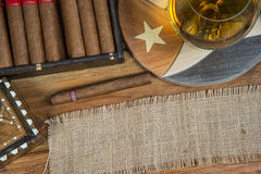 Cigars and Rum or alcohol on table Royalty Free Stock Photo