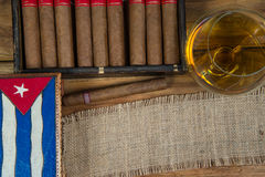 Cigars and Rum or alcohol on table Royalty Free Stock Images