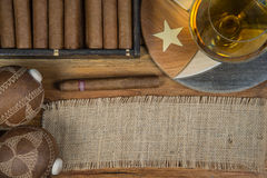 Cigars and Rum or alcohol on table Stock Image