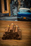 Cigars on rustic table Royalty Free Stock Photography