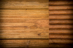 Cigars on rustic table Royalty Free Stock Photo