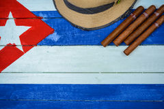 Cigars and straw hat Stock Photo