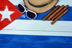 Cigars straw Panama hat and sun glasses Stock Photo