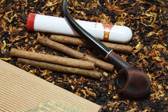 Cigars and a tube Royalty Free Stock Photography