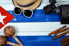Cigars and vintage camera with maracas Royalty Free Stock Images
